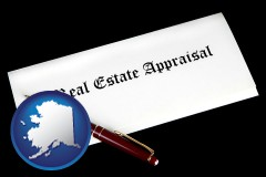 alaska real estate appraisal documents and a pen