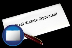 colorado real estate appraisal documents and a pen