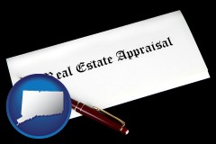 connecticut real estate appraisal documents and a pen