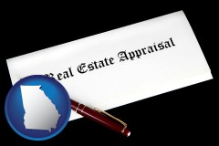 georgia real estate appraisal documents and a pen