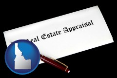 idaho real estate appraisal documents and a pen