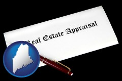 maine real estate appraisal documents and a pen