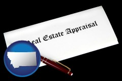 montana real estate appraisal documents and a pen