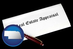 nebraska real estate appraisal documents and a pen