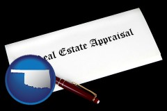 oklahoma real estate appraisal documents and a pen