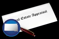 south-dakota real estate appraisal documents and a pen