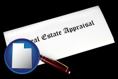 utah real estate appraisal documents and a pen