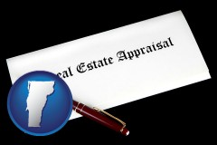 vermont real estate appraisal documents and a pen