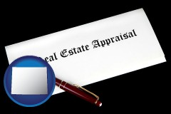 wyoming real estate appraisal documents and a pen