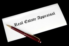 real estate appraisal documents and a pen