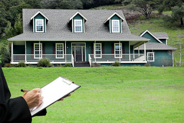 a real estate appraiser appraising a large country house